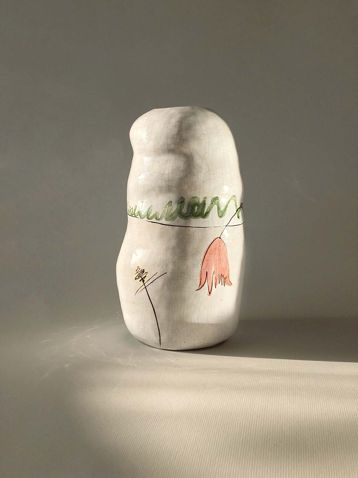 Decorative ceramic vase with tulips
