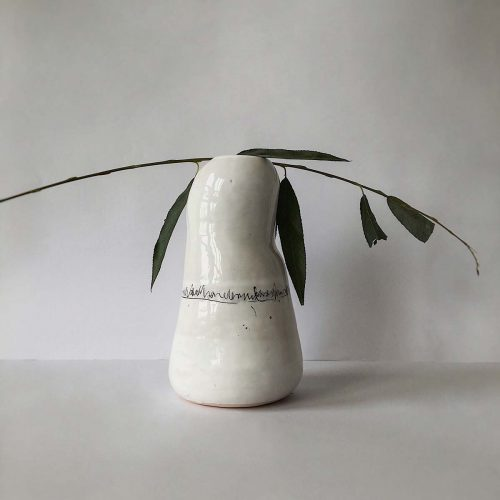 Vase for flowers with female silhouette