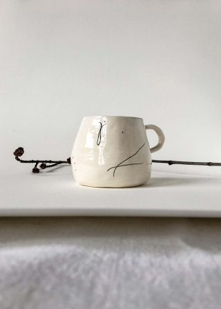 Ceramic cup handmade with abstract drawing