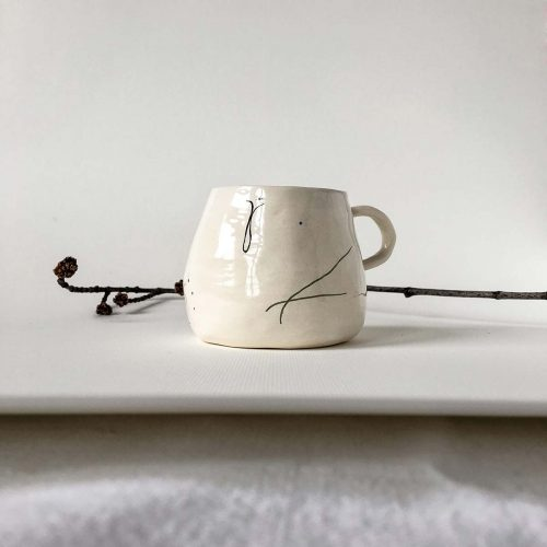 Cup with abstract drawing