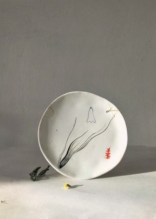 Plate handmade with artistic drawing