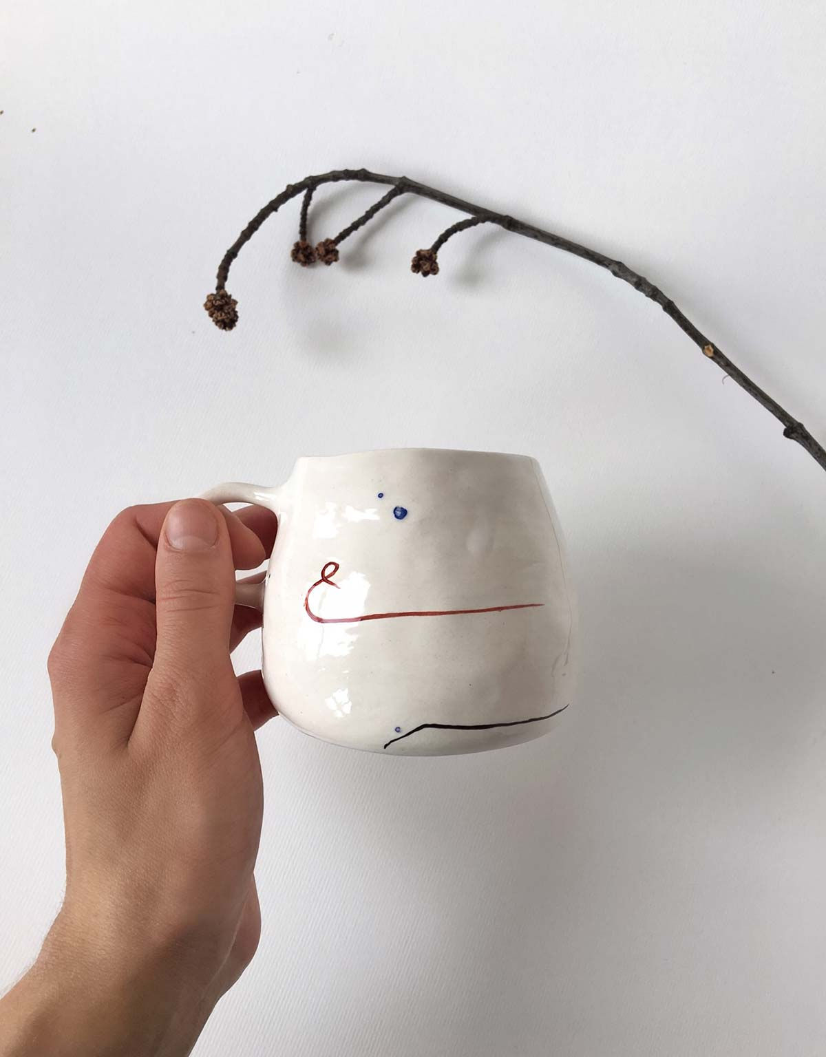 Side view - cup with abstract drawing
